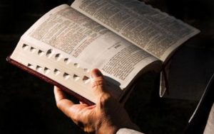 open Bible in man's hand