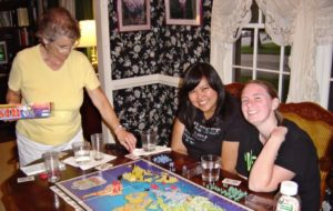 military girls playing Risk in home